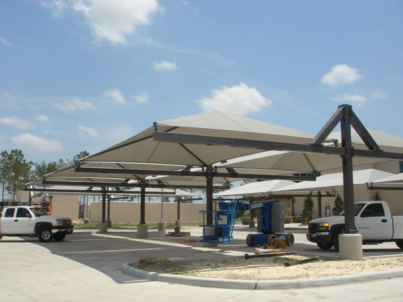 Parking shade parking lot shade sails shade structures for Shade structures